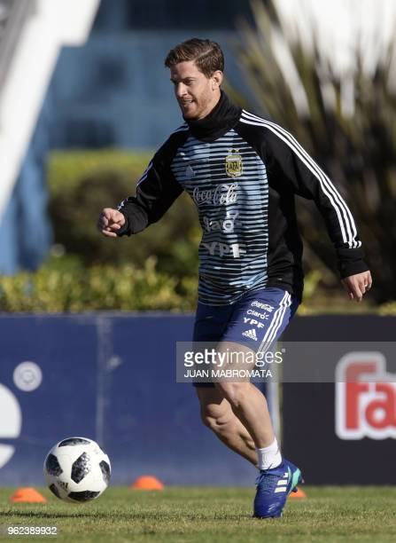 Argentina's national football team defender Cristian Ansaldi passes the ball during a training session in Ezeiza Buenos Aires on May 25 2018 The...
