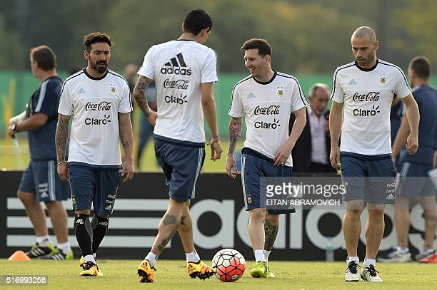 Argentina's national football team Ezequiel Lavezzi Angel Di Maria Lionel Messi and Javier Mascherano take part in a training session in Ezeiza...