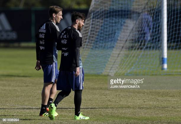 Argentina's national football team forward Lionel Messi and midfielder Lucas Biglia walk the pitch during a training session in Ezeiza Buenos Aires...
