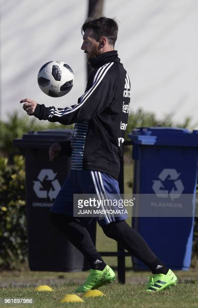 Argentina's national football team forward Lionel Messi controls the ball during a training session in Ezeiza Buenos Aires on May 23 2018 The...