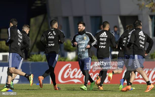 Argentina's national football team forward Lionel Messi warmsup along with his teammates during a training session in Ezeiza Buenos Aires on May 24...