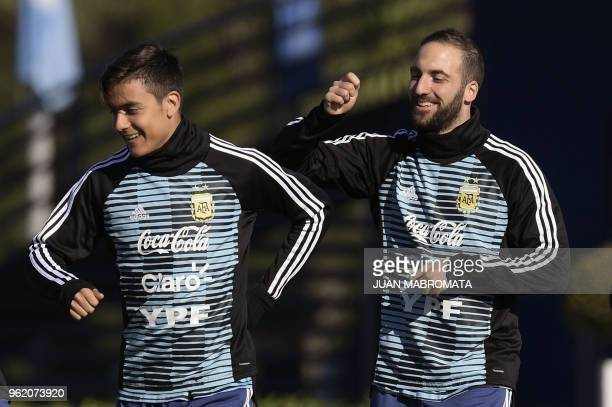 Argentina's national football team forward Paulo Dybala and forward Gonzalo Higuain warmup along with their teammates during a training session in...