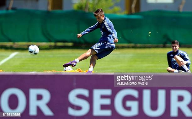 Argentina's national football team forward Paulo Dybala kicks the ball during a training session in Ezeiza Buenos Aires on October 9 2016 ahead of a...