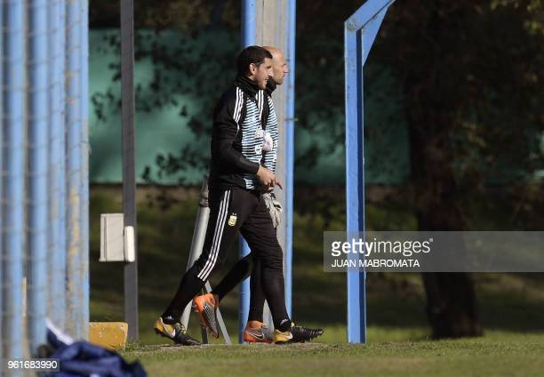 Argentina's national football team goalkeepers Nahuel Guzman and Wilfredo Caballero walk the pitch during a training session in Ezeiza Buenos Aires...