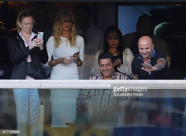 Argentina's national football team head coach Jorge Sampaoli waves at the crowd next World Cup Russia 2018 ambassador Victoria Lopyreva and...