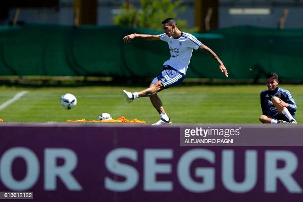 Argentina's national football team midfielder Angel Di Maria kicks the ball during a training session in Ezeiza Buenos Aires on October 9 2016 ahead...