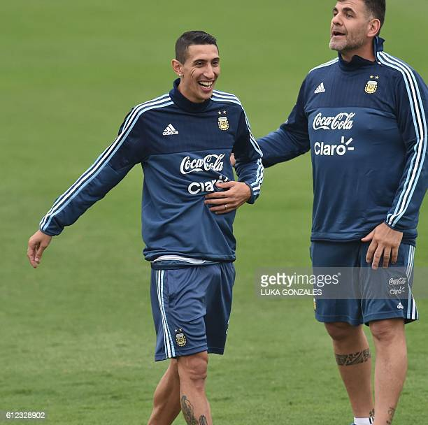 Argentina's national football team player Angel Di Maria jokes with an assistant during a training session in Lima on October 03 2016 Argentina will...