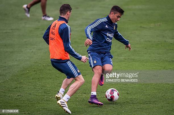 Argentina's national football team player Paulo Dybala during a training session in Lima on October 04 2016 Argentina will face Peru in a FIFA World...