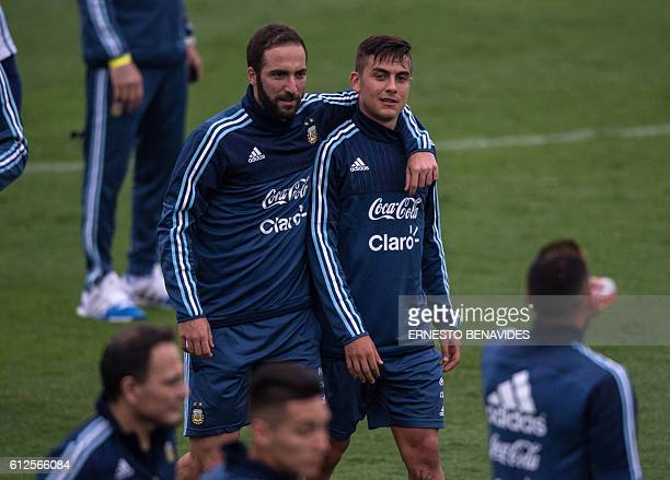 Argentina's national football team players Gonzalo Higuain walks with Paulo Dybala during a training session in Lima on October 04 2016 Argentina...