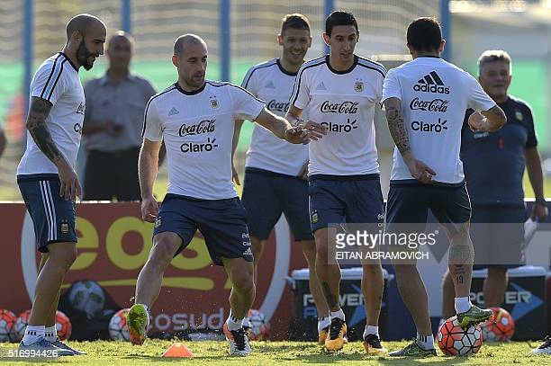 Argentina's national football team players Javier Pinola Pablo Zavaleta and Angel Di Maria take part in a training session in Ezeiza Buenos Aires on...