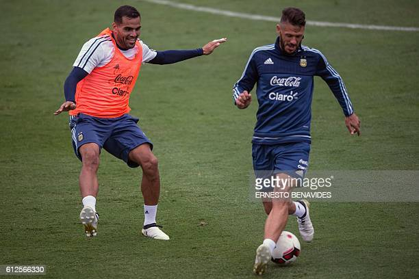 Argentina's national football team players Sergio Romero and Martin Demichelis take part in a training session in Lima on October 04 2016 Argentina...