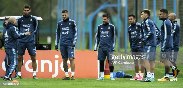 Argentina's national footballers listen to an assistant during a training session in Ezeiza Buenos Aires on September 3 2017 ahead of a 2018 FIFA...