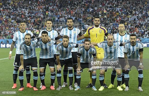 Argentina's national team Argentina's defender Marcos Rojo Argentina's defender Martin Demichelis Argentina's defender Ezequiel Garay Argentina's...