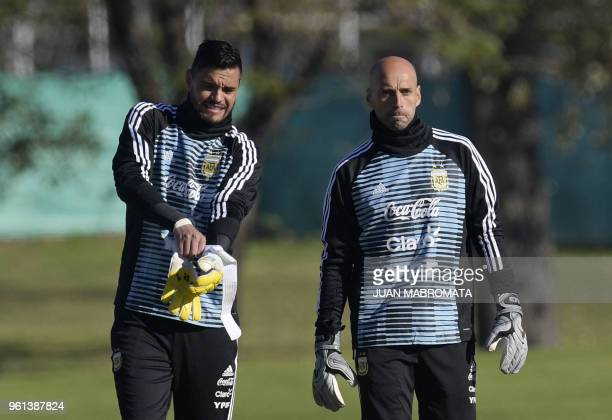 Argentina's national team goalkeepers Sergio Romero and Willy Caballero arrive to a training session in Ezeiza Buenos Aires on May 22 2018 The...