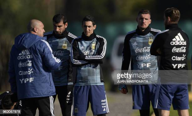 Argentina's national team phisycal trainer Jorge Desio talks to goalkeeper Nahuel Guzman midfielder Angel Di Maria goalkeeper Franco Armani and...