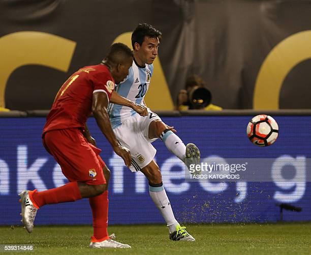 Argentina's Nicolas Gaitan kicks the ball past Panama's Amilcar Henriquez during the Copa America Centenario football tournament in Chicago Illinois...