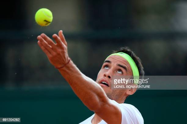 Argentina's Nicolas Kicker serves the ball to Uruguay's Pablo Cuevas during their tennis match at the Roland Garros 2017 French Open on June 1 2017...