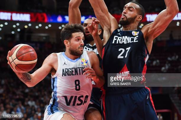 Argentina's Nicolas Laprovittola goes for the basket as France's Rudy Gobert tries to defend during the Basketball World Cup semifinal game between...