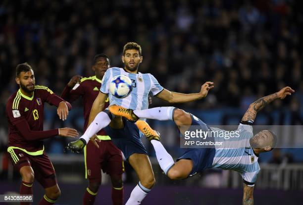 Argentina's Nicolas Otamendi and Argentina's Federico Fazio attempt to control the ball during their 2018 World Cup qualifier football match in...