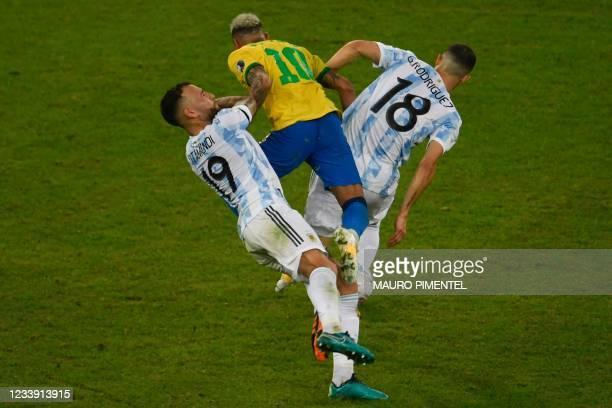 Argentina's Nicolas Otamendi and Argentina's Guido Rodriguez collide with Brazil's Neymar during the Conmebol 2021 Copa America football tournament...