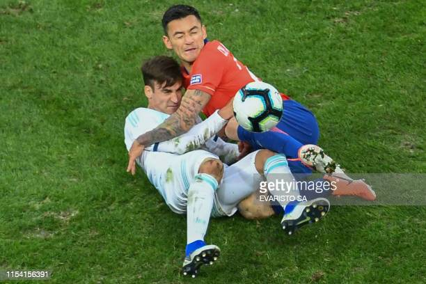 TOPSHOT Argentina's Nicolas Tagliafico and Chile's Charles Aranguiz vie for the ball during their Copa America football tournament thirdplace match...