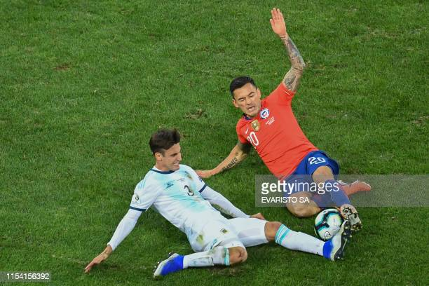 Argentina's Nicolas Tagliafico and Chile's Charles Aranguiz vie for the ball during their Copa America football tournament thirdplace match at the...