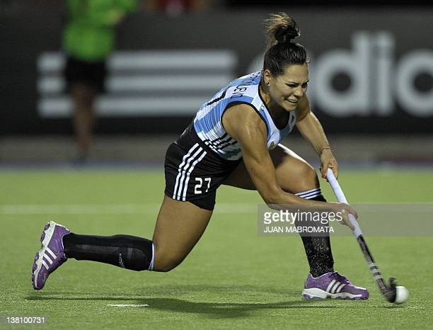 Argentina's Noel Barrionuevo takes a penalty shot to score against China during their Champions Trophy 2012 quarterfinals field hockey match in...