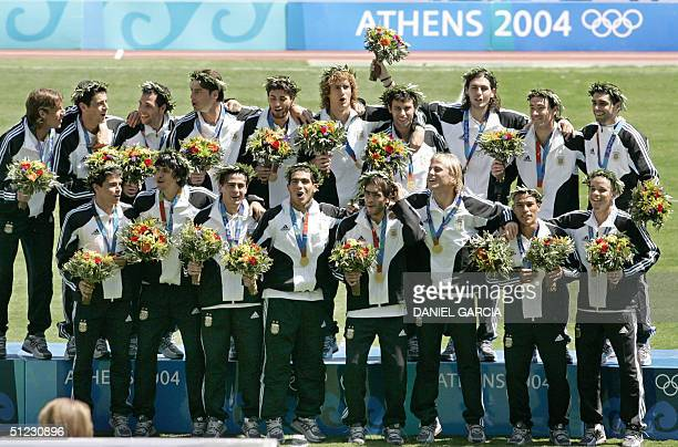 Argentina's Olympic men's football team pose for the picture after receiving the gold medal 28 August 2004 in Athens Argentina defeated Paraguay by...