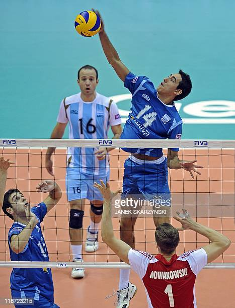 Argentina's Pablo Crer with Luciano del Cecco and Alexis Gonzalez spikes the ball against Poland's Piotr Nowakowski on July 10 2011 during their...