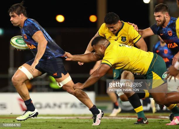 TOPSHOT Argentina's Pablo Matera beats the tackle of Australia's Taniela Tupou during the Rugby Championship match between Australia and Argentina on...