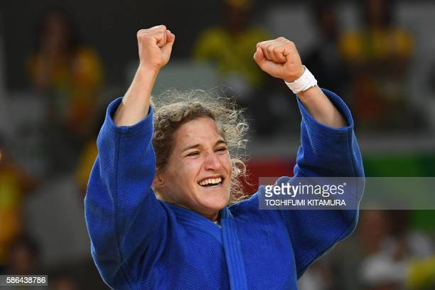 TOPSHOT Argentina's Paula Pareto celebrates after defeating South Korea's Jeong Bokyeong during their women's 48kg judo contest gold medal match of...