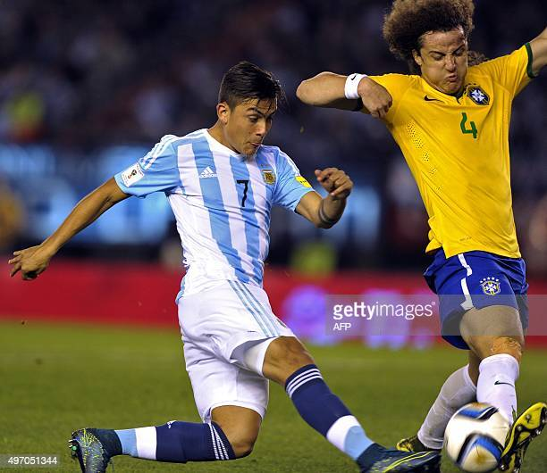 Argentina's Paulo Dybala and Brazil's David Luiz vie for the ball during their Russia 2018 FIFA World Cup South American Qualifiers football match in...
