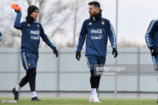 Argentina's Paulo Dybala and Lionel Messi take part in a training session in Moscow on November 7 2017 The team will face Russia in friendly match on...