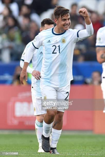 Argentina's Paulo Dybala celebrates after scoring against Chile during their Copa America football tournament thirdplace match at the Corinthians...