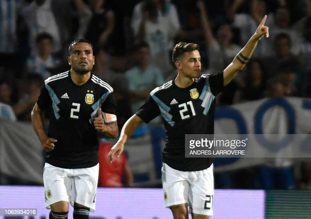 Argentina's Paulo Dybala celebrates after scoring his second goal against Mexico during their friendly football match at Malvinas Argentinas stadium...