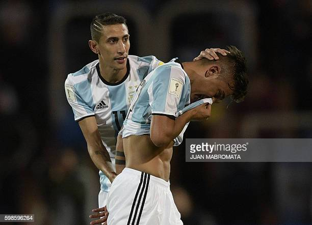 Argentina's Paulo Dybala is comforted by Argentina's Angel Di Maria whilst leaving the field after receiving a red card during the FIFA World Cup...