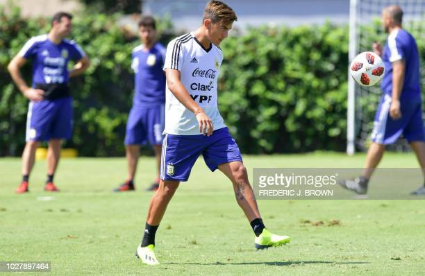 Argentina's Paulo Dybala kicks the ball during a training session in Carson California on September 6 ahead of the international soccer friendly...