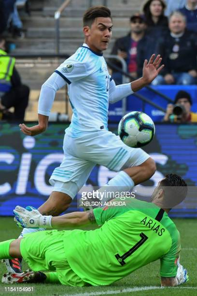 Argentina's Paulo Dybala scores past Chile's goalkeeper Gabriel Arias during their Copa America football tournament thirdplace match at the...