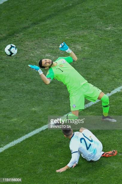 TOPSHOT Argentina's Paulo Dybala scores past Chile's goalkeeper Gabriel Arias during their Copa America football tournament thirdplace match at the...