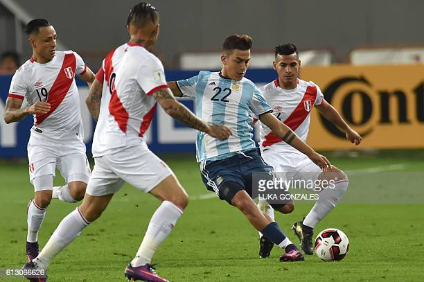 Argentina's Paulo Dybala vies for the ball with Peru's Paolo Guerrero and Miguel Trauco during their Russia 2018 World Cup qualifier football match...