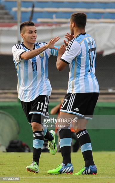 Argentina's player Angel Correa celebrates with Joaquin Ibanez the team's second goal against Peru during their South American U 20 football match at...
