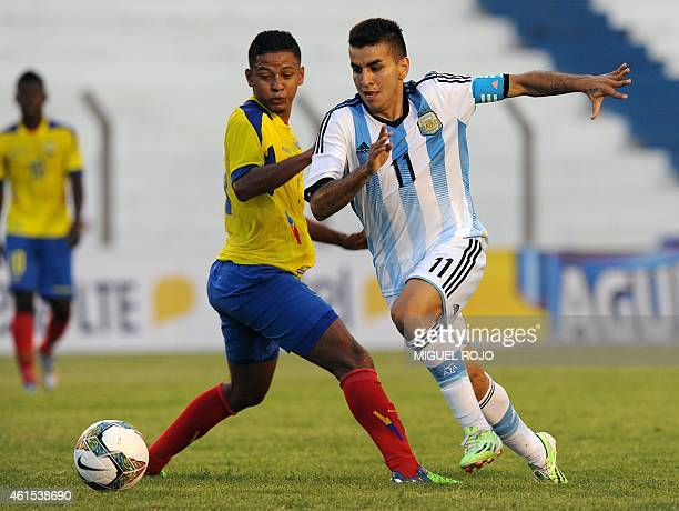 Argentina's player Angel Correa vies for the ball with Ecuador's Gabriel Corozo during their South American U20 football match at the Campus Stadium...