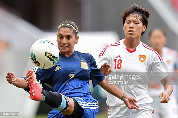 Argentina's player Debora Molina vies for the ball with China's player Han Peng during their Brasilia International Tournament football 3rd place...