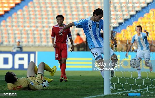 Argentina's player Facundo Ferreyra kicks the ball again in celebration after scoring against North Korea during their FIFA U20 World Cup football...