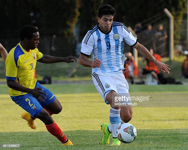 Argentina's player Giovanni Simeone vies for the ball with Ecuador's Gabriel Corozo, during their South American U-20 football match at the Campus...