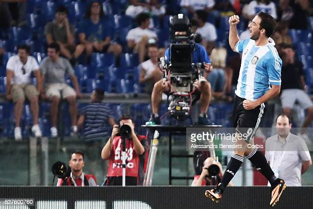 Argentina's Player Gonzalo Higuanin celebrates after scoring against Italy during a friendly Soccer Match played by Italy and Argentina at Rome's...