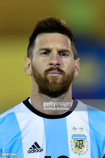 Argentina's player Lionel Messi poses for pictures before the start of their 2018 World Cup qualifier football match against Ecuador in Quito on...