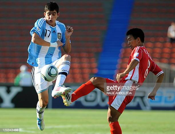 Argentina's player Rodrigo Battaglia vies with North Korea's Ri Hyon Song during their FIFA U20 World Cup football tournament match held at the...