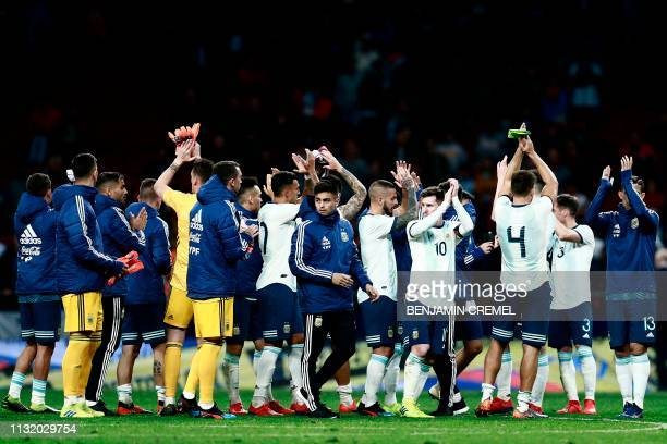 Argentina's players acknowledge fans at the end of an international friendly football match between Argentina and Venezuela at the Wanda...