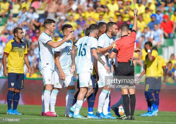 Argentina's players argue with the referee during the International Friendly football match against Ecuador at the Martinez Valero stadium in Elche,...